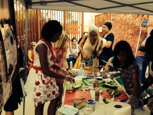 Festival attendees enjoy a food demonstration.